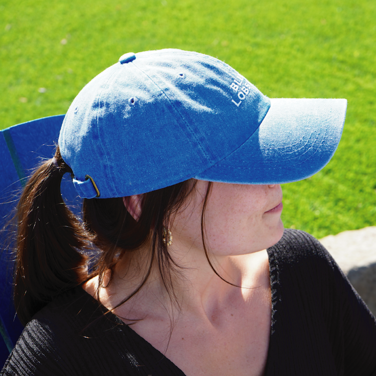 A woman wearing a Blue Lobster Dad Hat