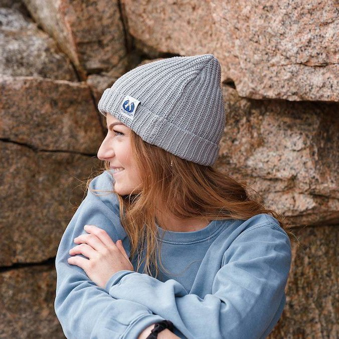 A person wearing a Blue Lobster tagged grey knit toque